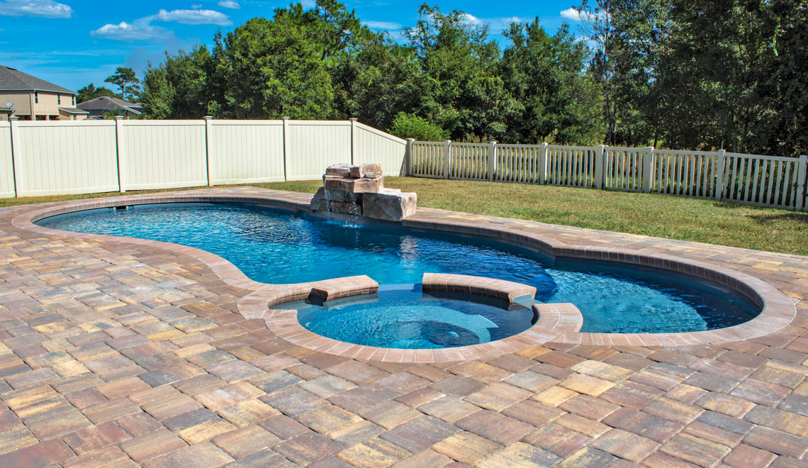 Leisure Pools Allure large in-ground composite swimming pool with built-in spa and splash deck