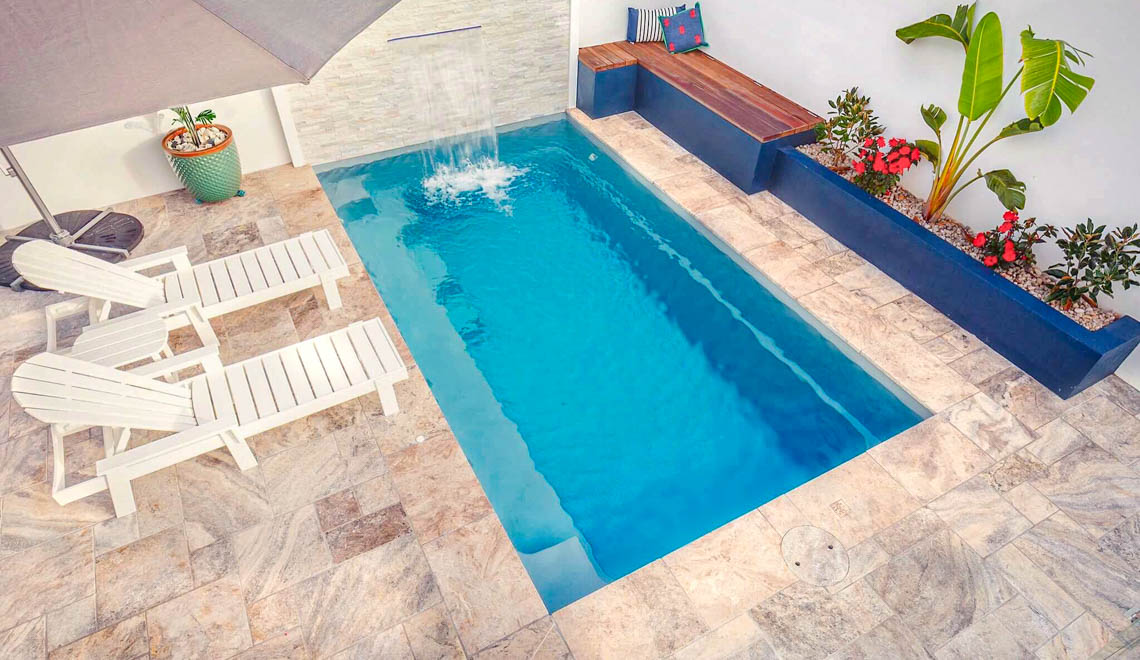 Leisure Pools Harmony compact fiberglass swimming pool