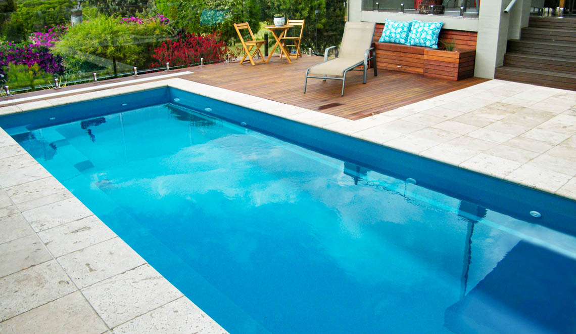 Leisure Pools Harmony fiberglass swimming pool with perimeter safety ledge