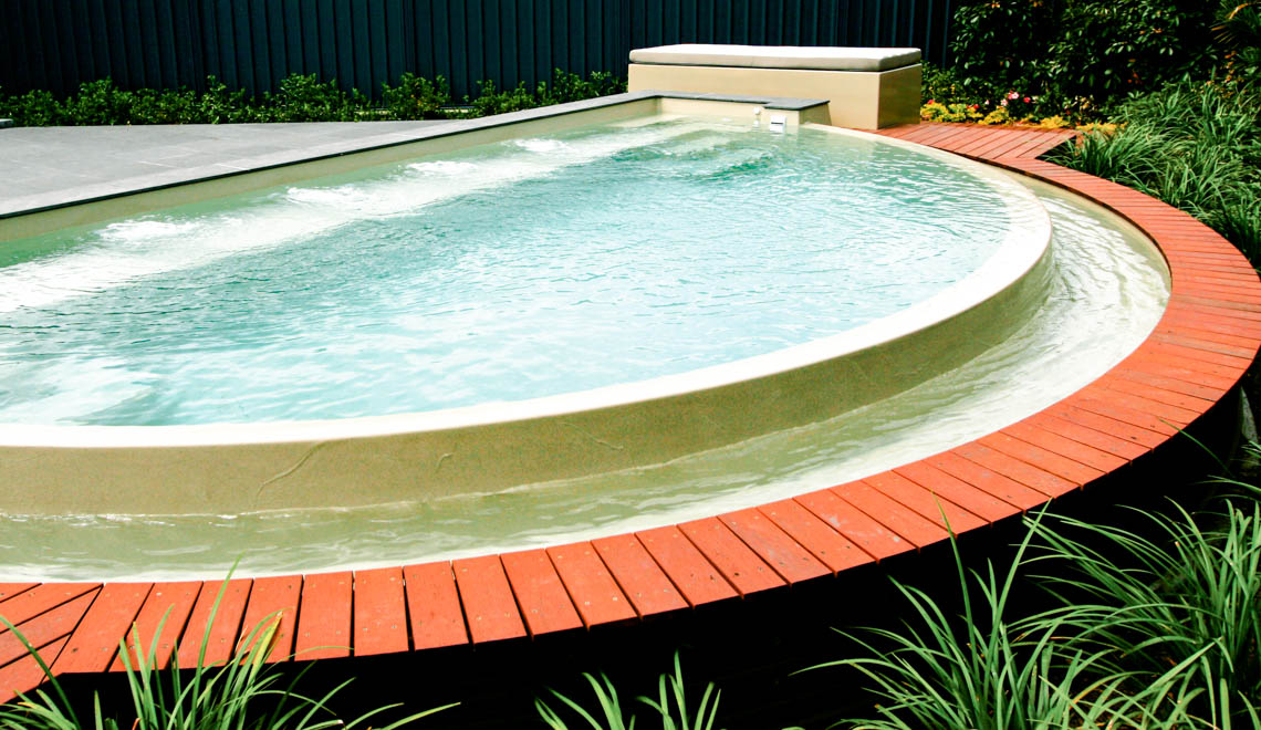 Leisure Pools Horizon composite swimming pool with an infinity edge