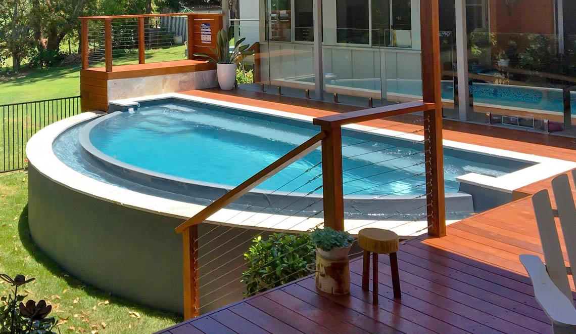Leisure Pools Horizon composite fiberglass swimming pool with an infinity edge
