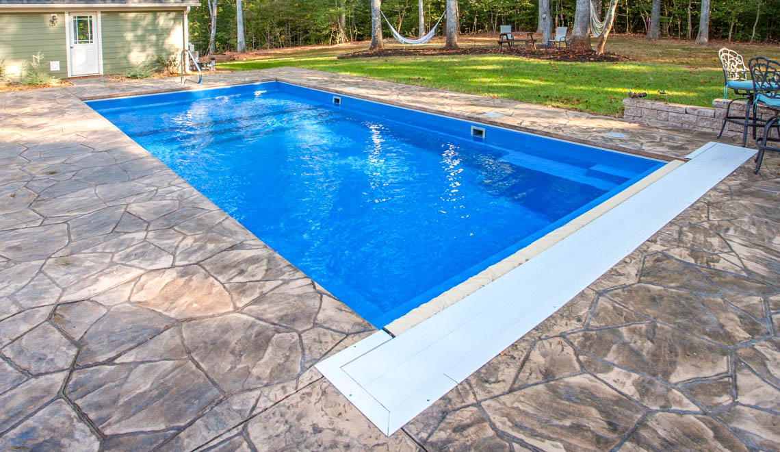 Leisure Pools Pinnacle large composite swimming pool with built-in splash deck