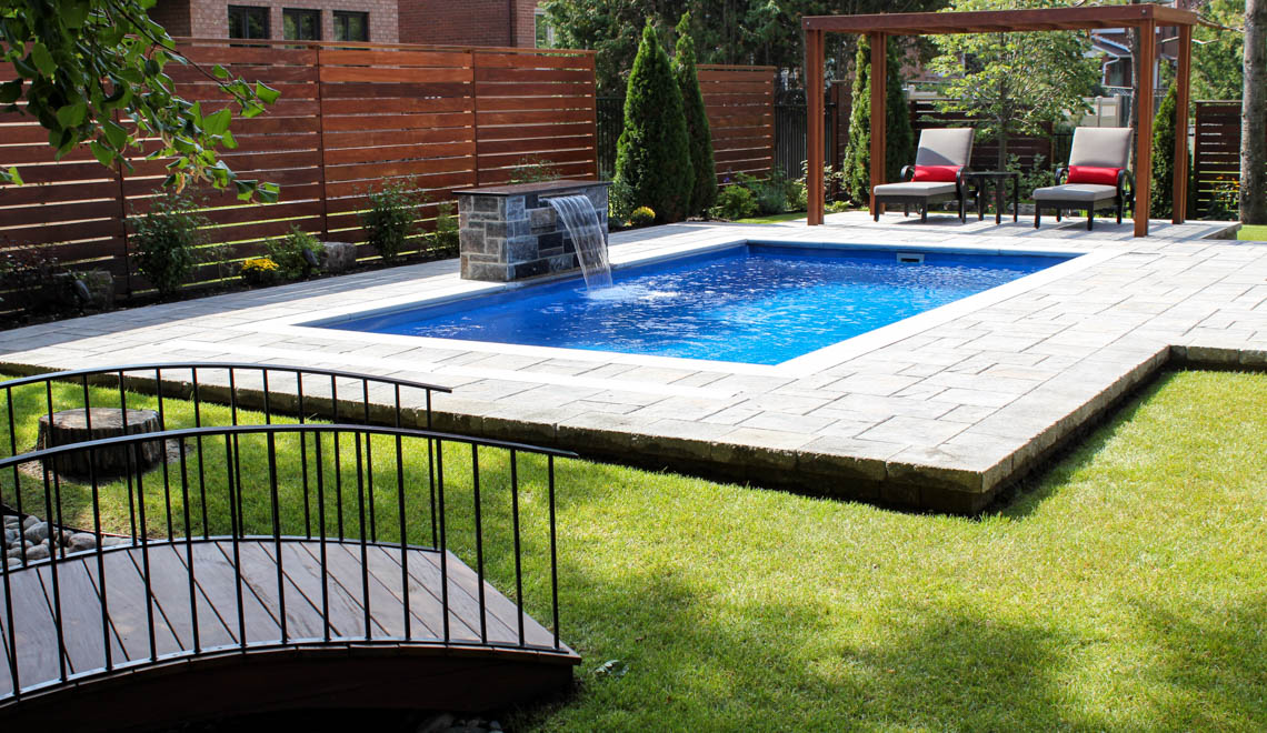 Leisure Pools Reflection composite fiberglass swimming pool with perimeter safety ledge