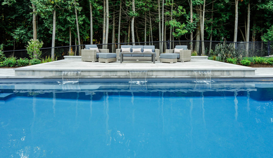 Leisure Pools Supreme composite fiberglass swimming pool with deep end swimout and bench seats