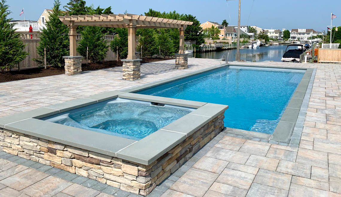Leisure Pools Supreme composite in-ground swimming pool with perimeter safety ledge