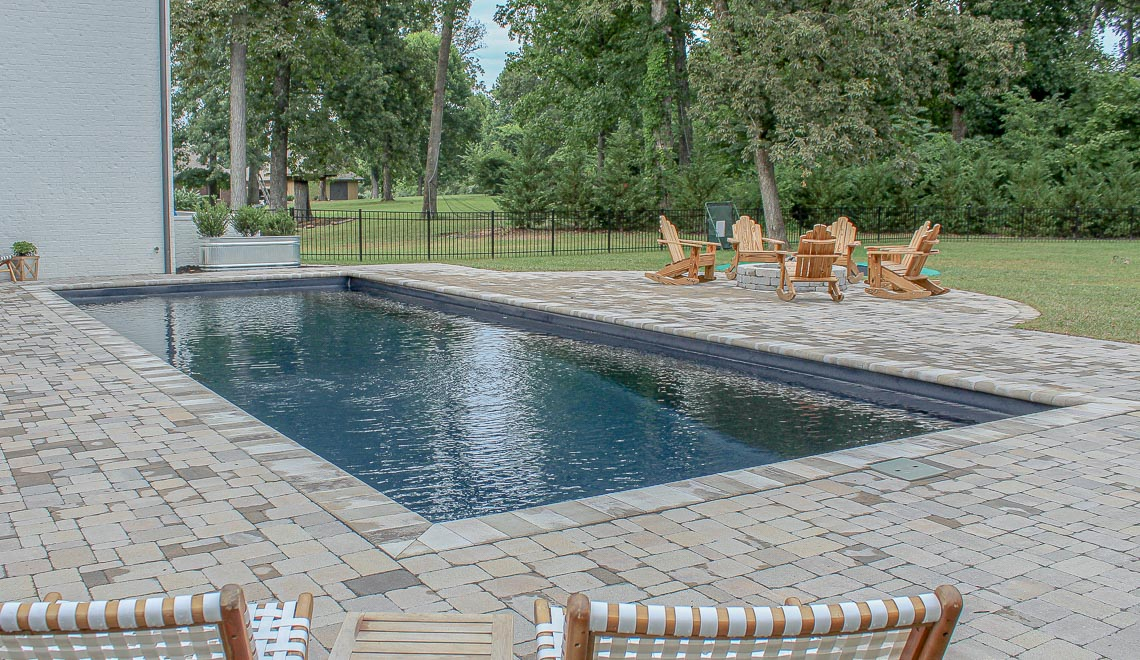 Leisure Pools Infinity large precast composite swimming pool with built-in steps and bench