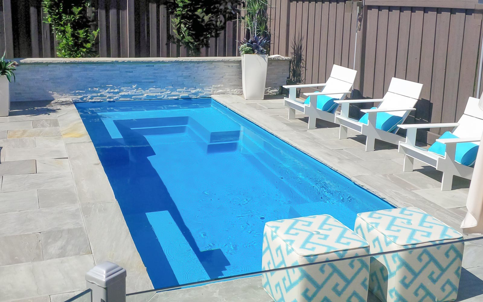 Leisure Pools Palladium Plunge fiberglass swimming pool with built-in bench