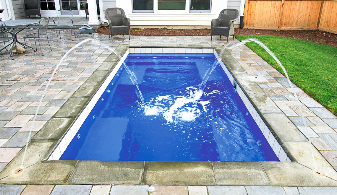 Leisure Pools Palladium Plunge composite in-ground swimming pool with wrapped bench area