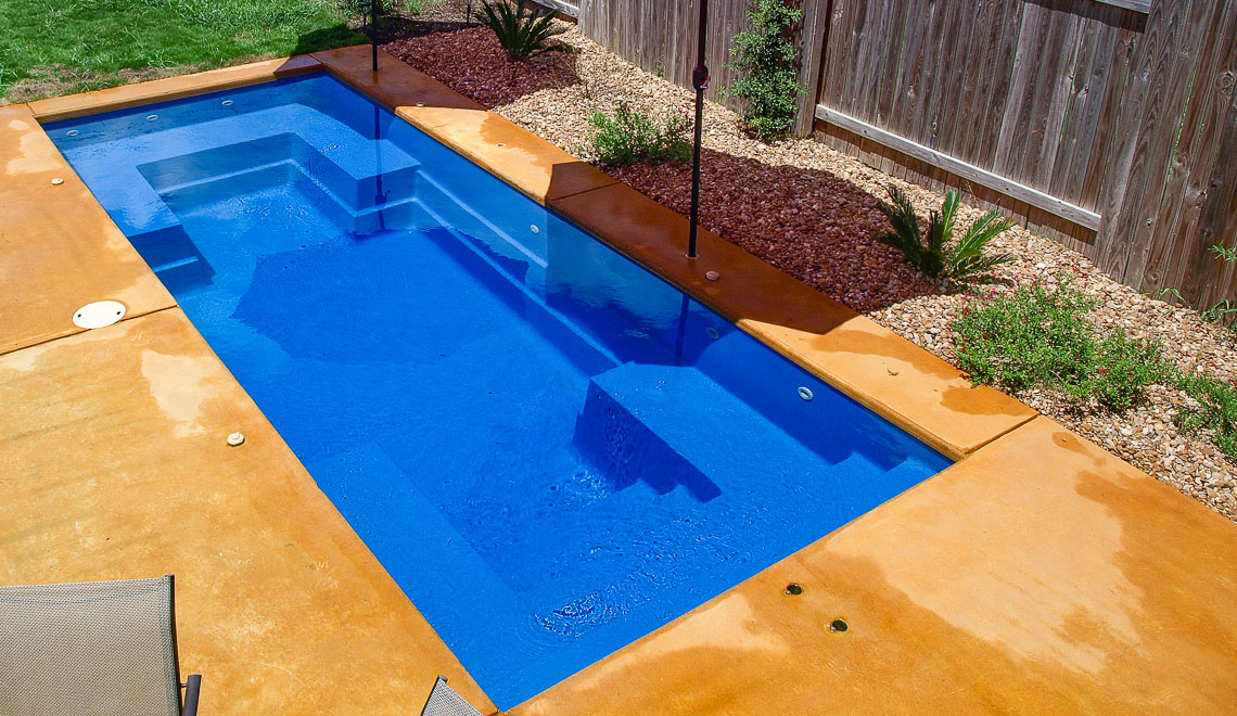 Leisure Pools Palladium Plunge composite swimming pool with wraparound bench and built-in steps