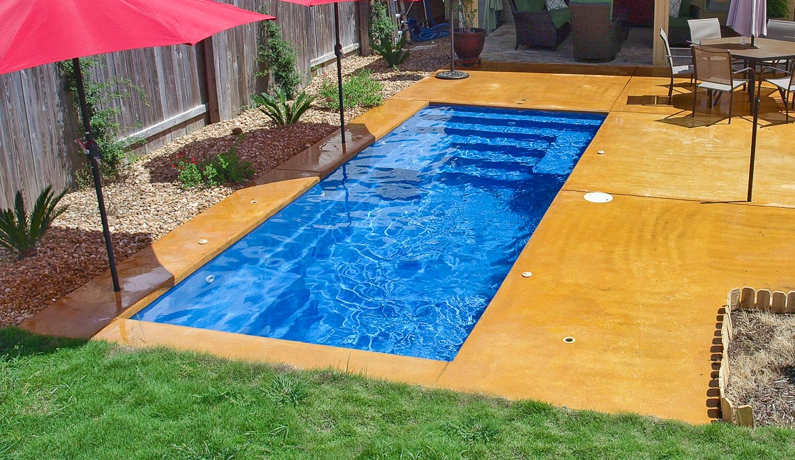 Leisure Pools Palladium Plunge composite swimming pool with wrapped bench area