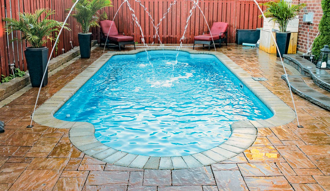 Leisure Pools Roman composite fiberglass swimming pool with spa nook and swimout