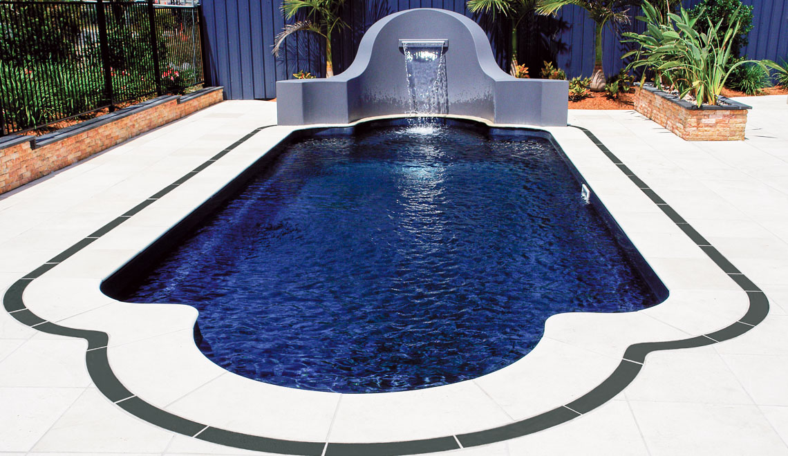 Leisure Pools Roman composite fiberglass swimming pool with perimeter safety ledge