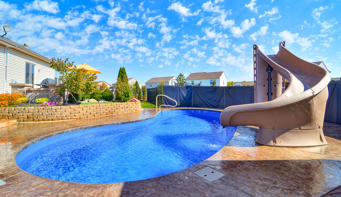Leisure Pools Tuscany freeform composite fiberglass swimming pool with perimeter safety ledge