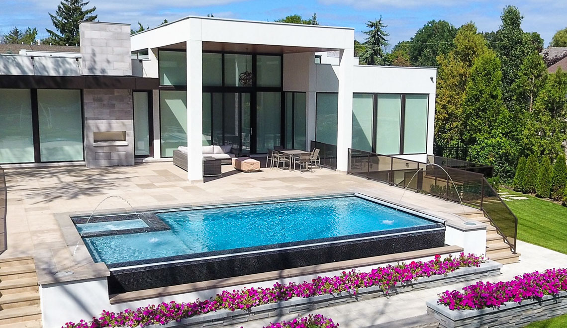 Leisure Pools Ultimate rectangular swimming pool with built-in spa and tanning ledge