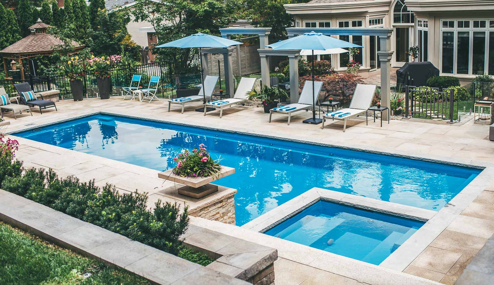 Leisure Pools Ultimate large composite unground pool with built-in spa and tanning ledge