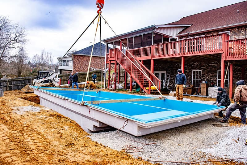 Delivering and placing a Leisure Pools fiberglass swimming pool