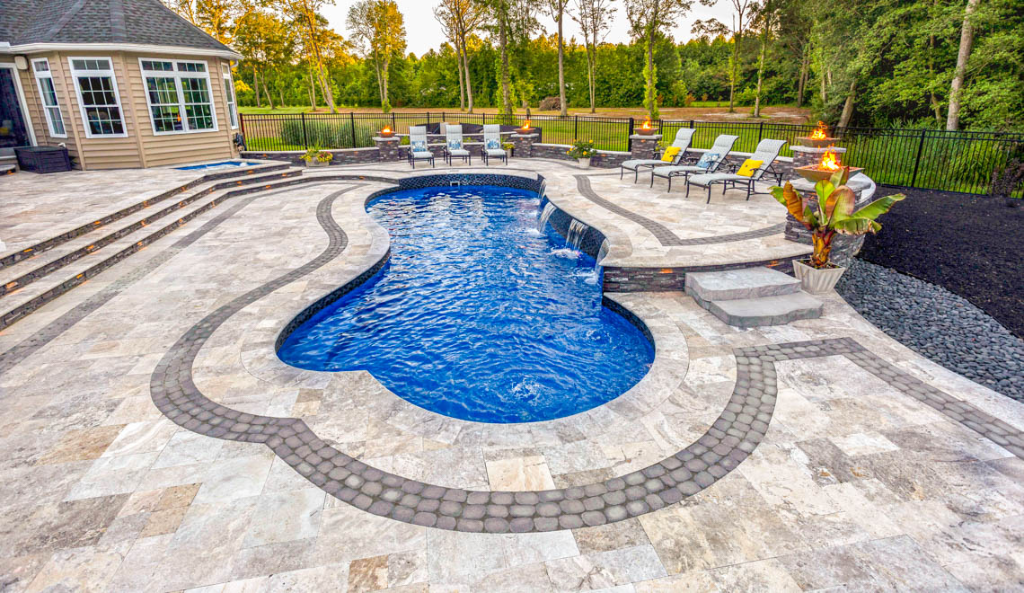 Leisure Pools Eclipse in-ground fiberglass swimming pool with built-in splash deck