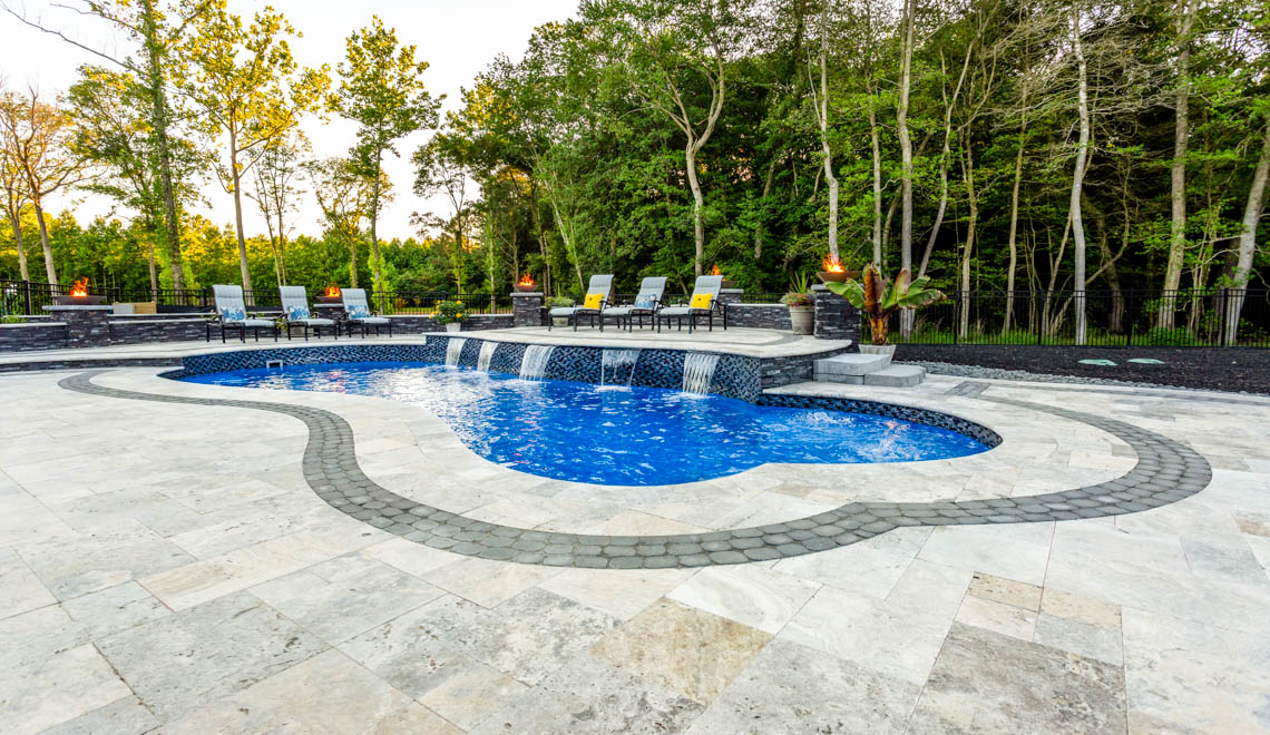 Leisure Pools Eclipse freeform fiberglass swimming pool with built-in splash deck