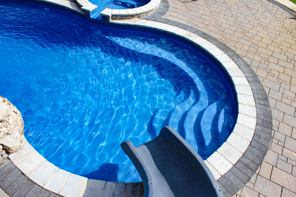 Leisure Pools Mediterranean composite freeform diving pool with wrap-around bench