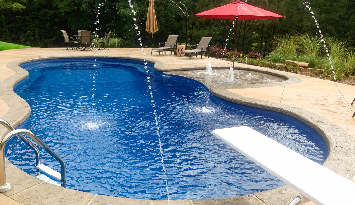Leisure Pools Mediterranean fiberglass freeform swimming pool with an 8-foot depth