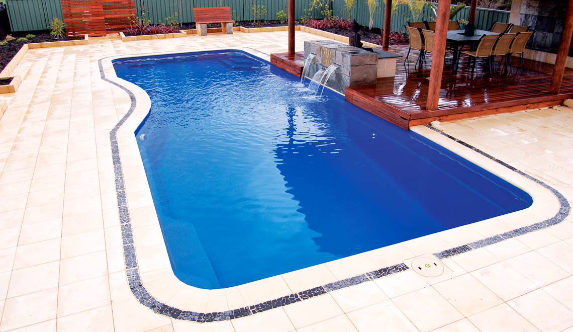 Leisure Pools Moroccan fiberglass swimming pool with built-in safety ledge