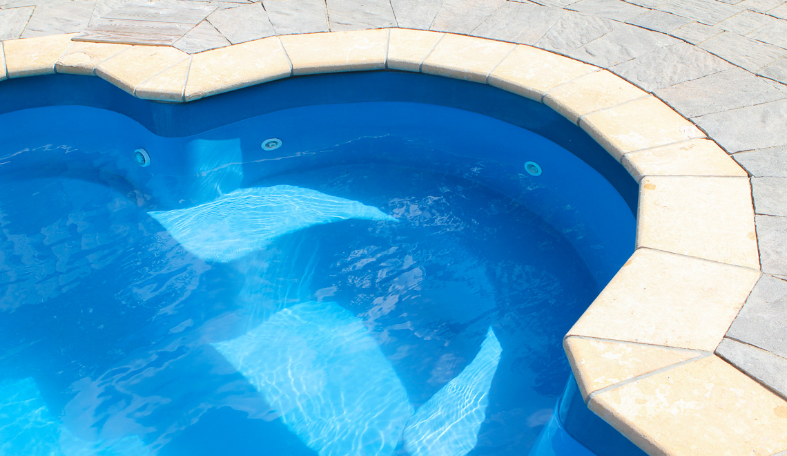 Leisure Pools Courtyard Roman inground fiberglass pool