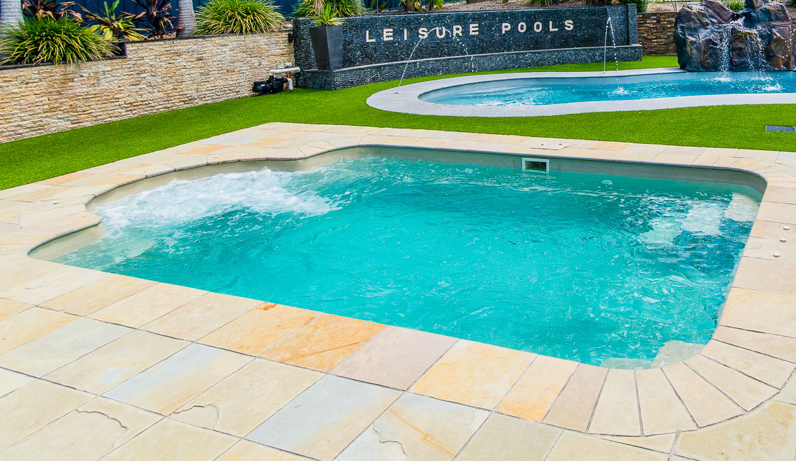 Leisure Pools Courtyard Roman in-ground fiberglass swimming pool