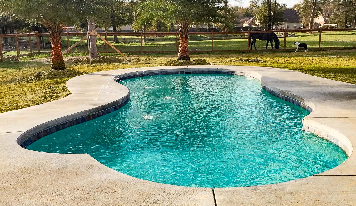 Leisure Pools Eclipse composite fiberglass swimming pool with built-in splash deck