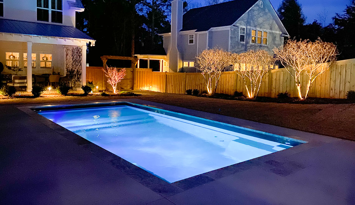 Leisure Pools Summit large composite swimming pool with integrated splash deck