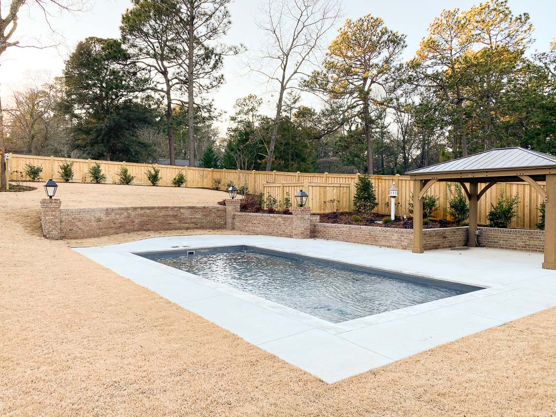 Leisure Pools Summit in-ground composite fiberglass swimming pool with integrated splash deck