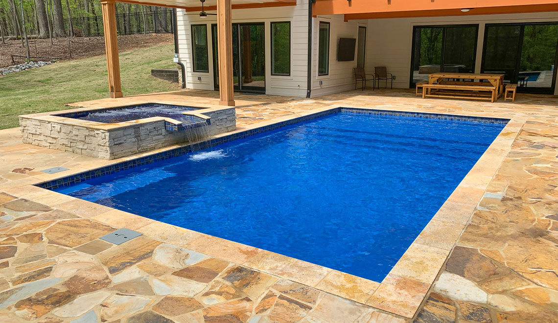 Leisure Pools Summit large composite fiberglass swimming pool with integrated splash deck